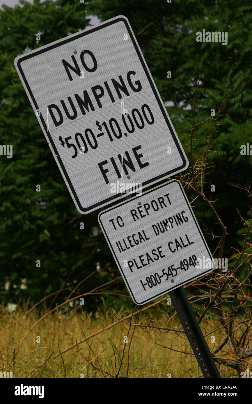 A sign posted to discourage illegal dumping in Detroit's west side. - Stock Image