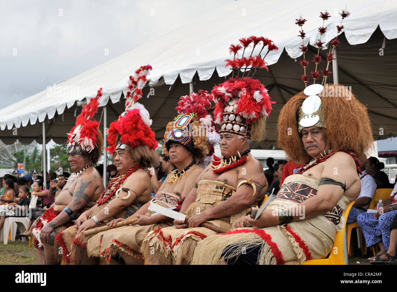 Five Matai (chiefs) with traditional headdress watch the celebrations of Samoa's 50 years of independence - Stock Image