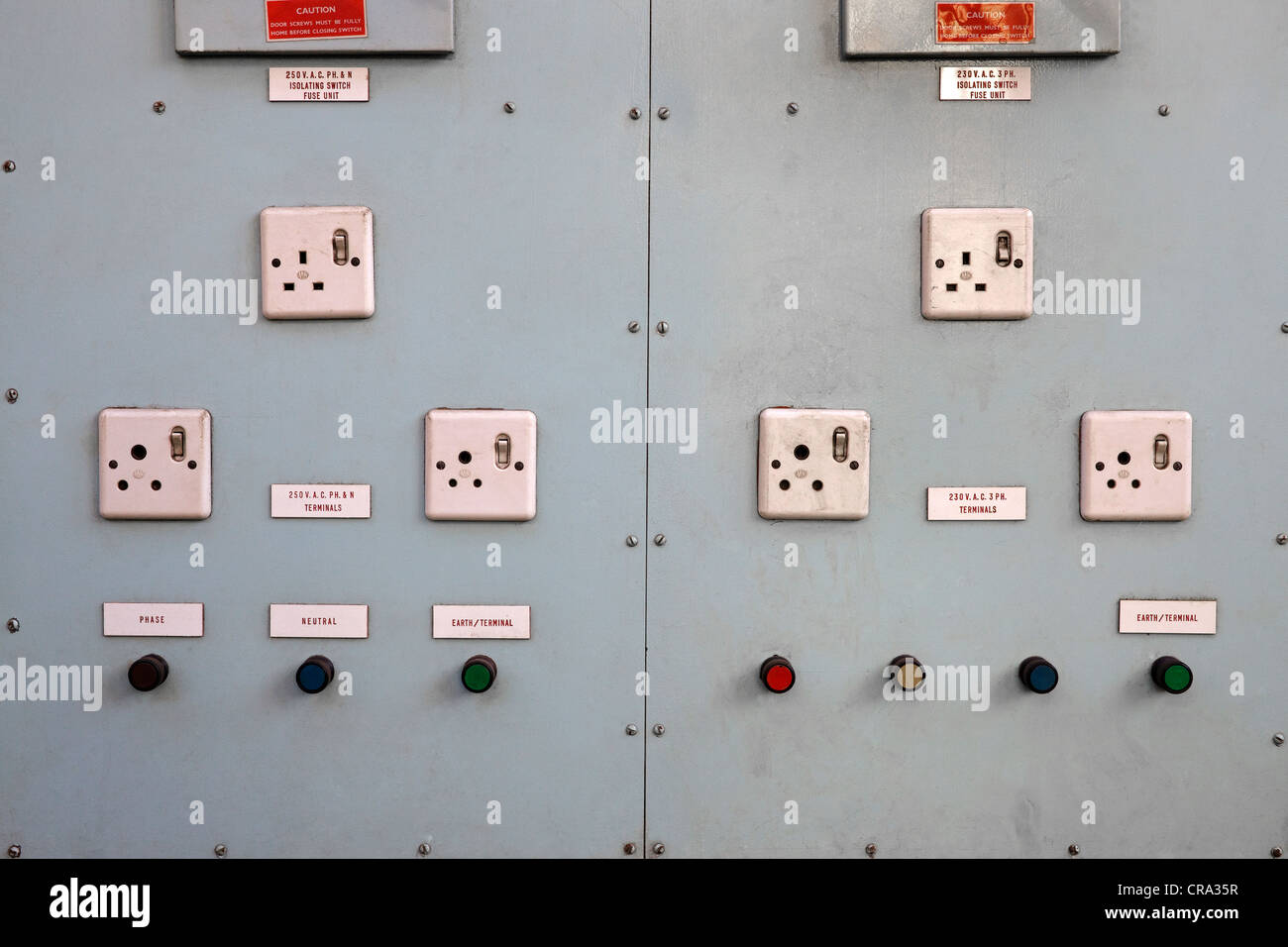 Control panel of 13 amp switches and buttons - Stock Image