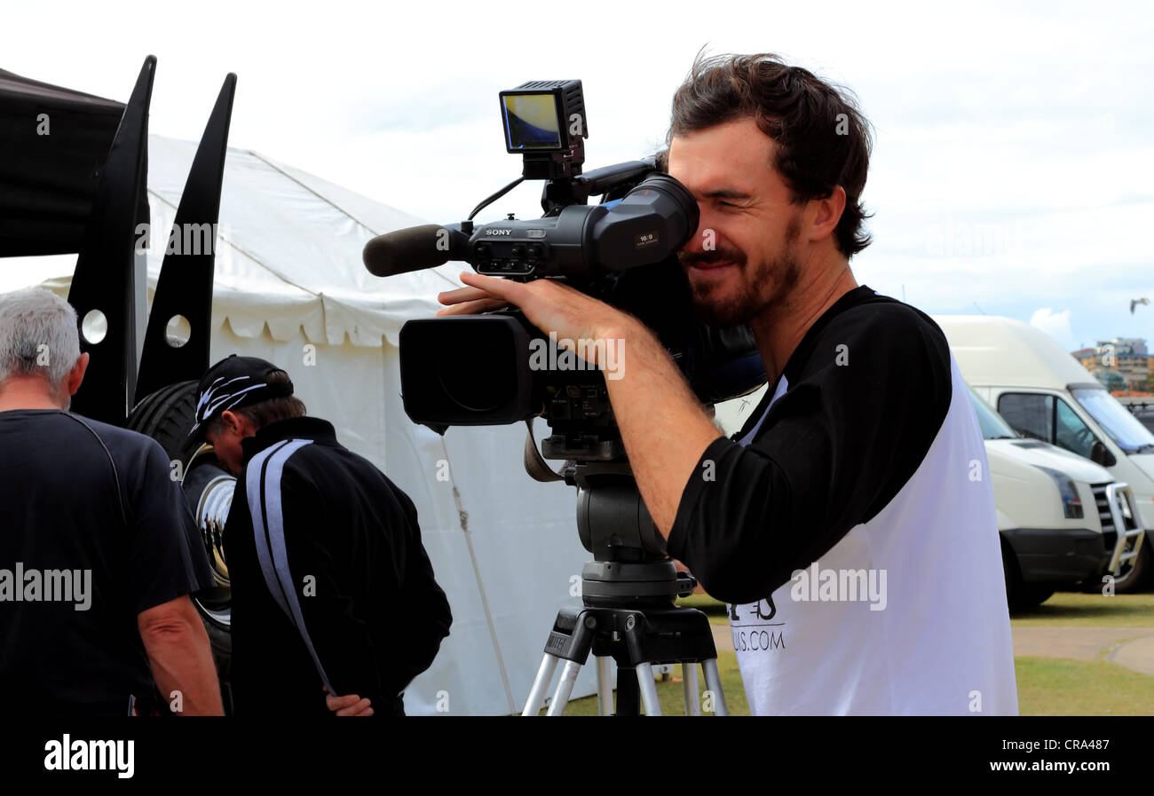 TV cameraman captures the crowds at the 'Cooly Rocks On' annual 50's & 60's Rock and Roll festival - Stock Image