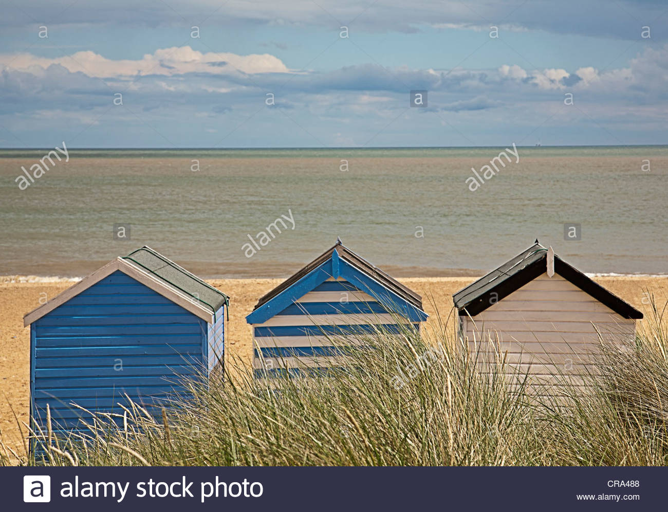 Brightly colored huts on beach - Stock Image
