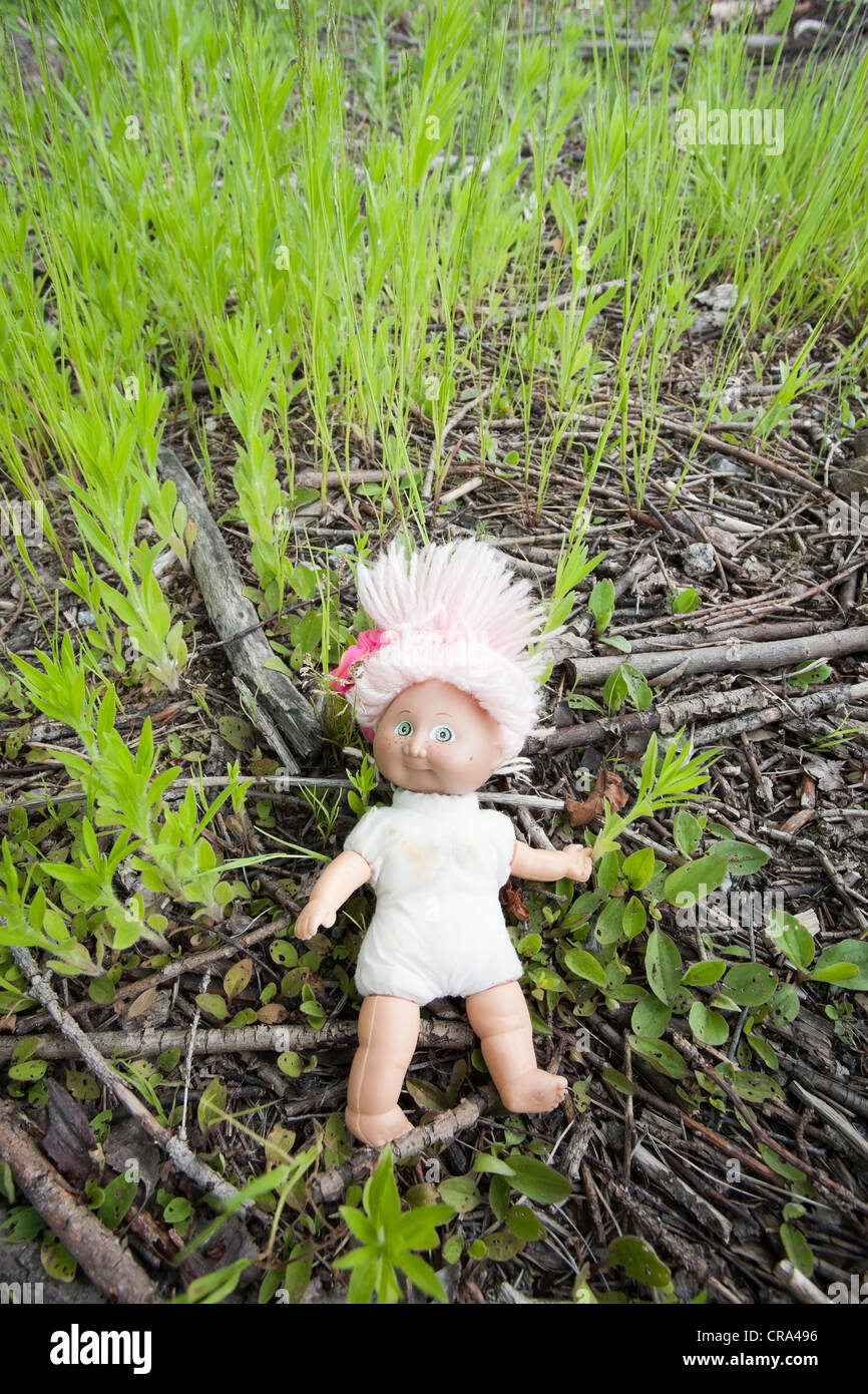 lost doll on ground - Stock Image