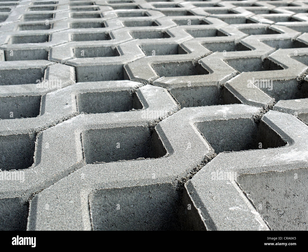 Closeup of openwork concrete pavement - Stock Image