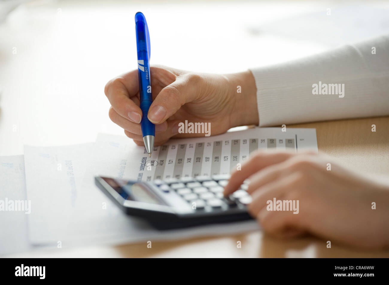 Calculation, calculator, detail, hands - Stock Image