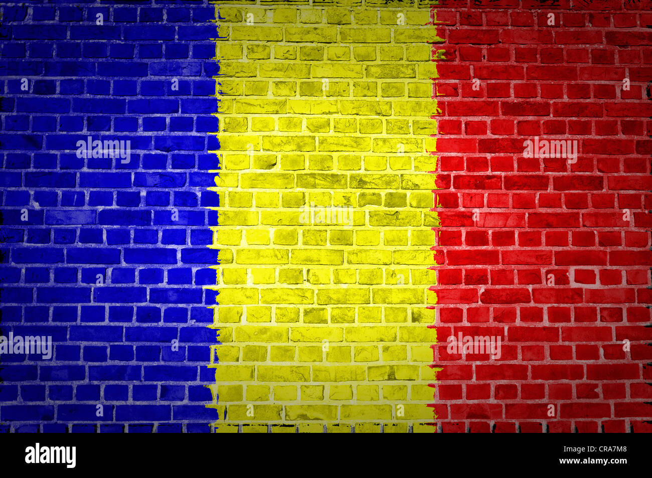 An image of the Chad flag painted on a brick wall in an urban location - Stock Image