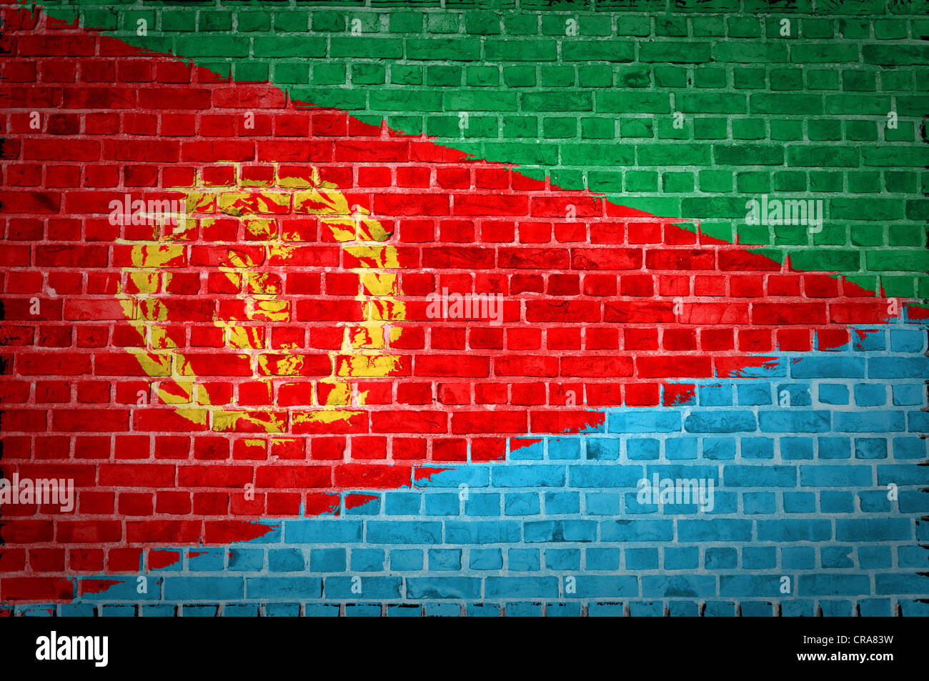 An image of the Eritrea flag painted on a brick wall in an urban location - Stock Image