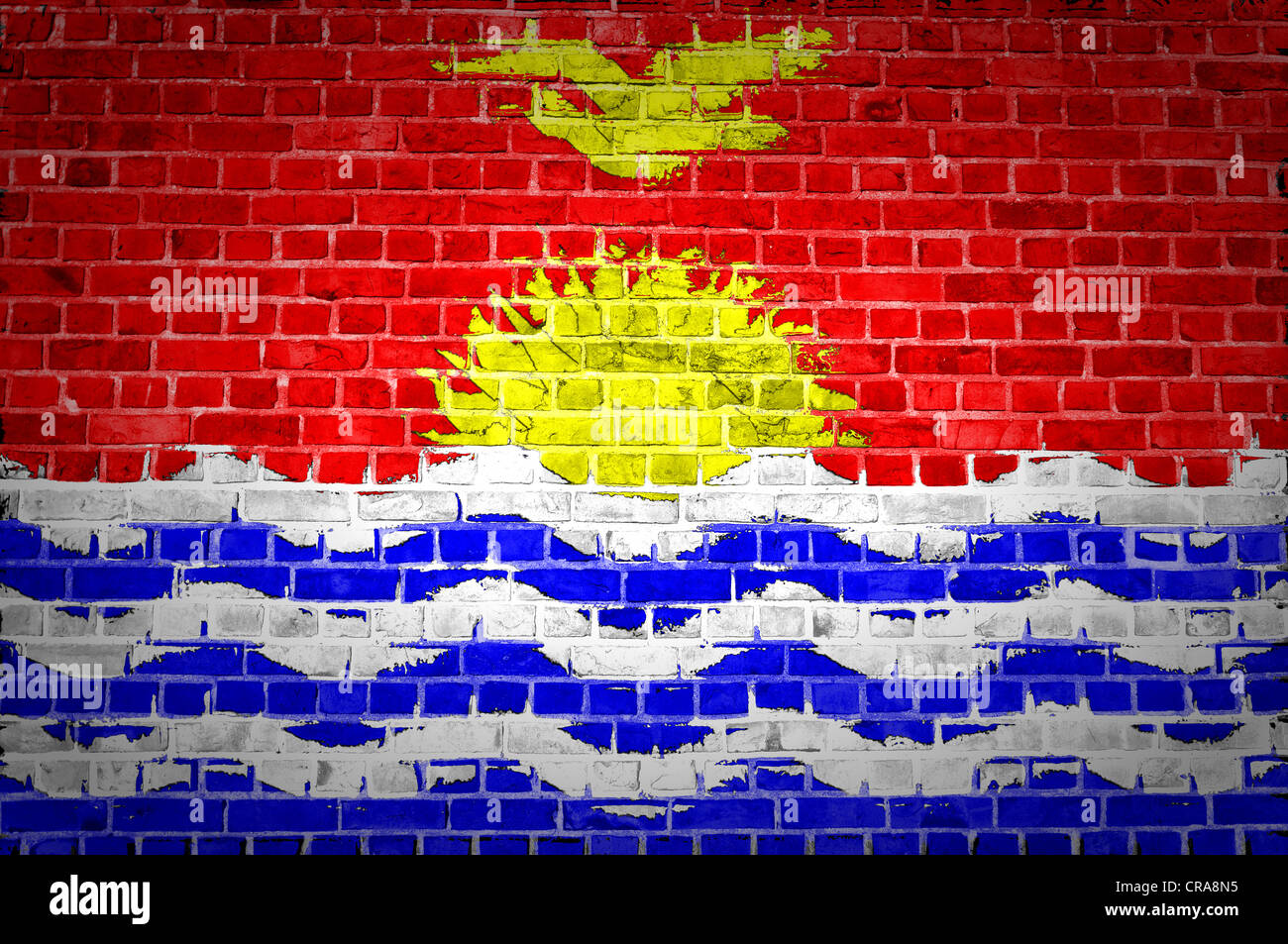 An image of the Kiribati flag painted on a brick wall in an urban location - Stock Image