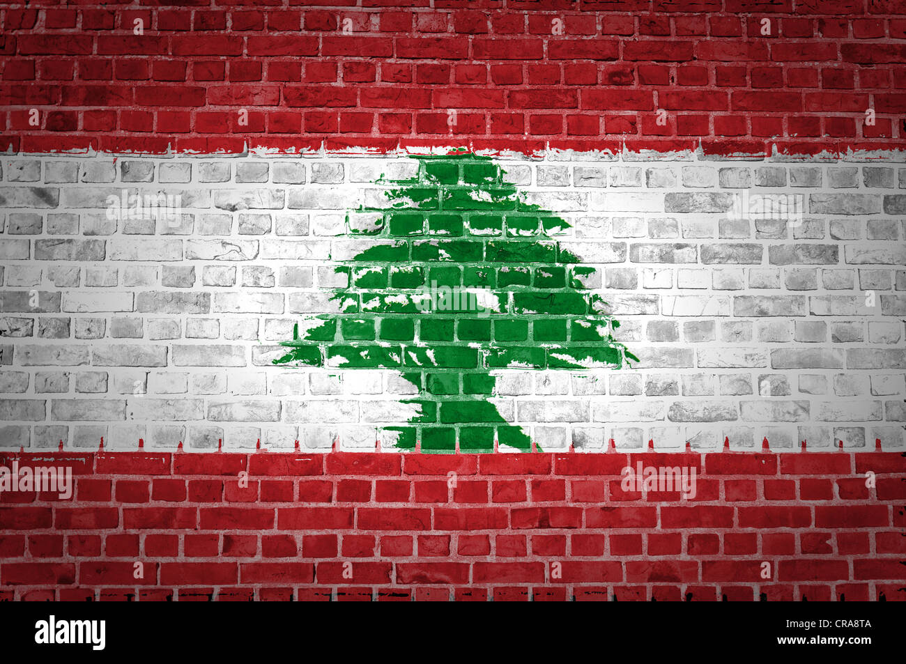 An image of the Lebanon flag painted on a brick wall in an urban location - Stock Image