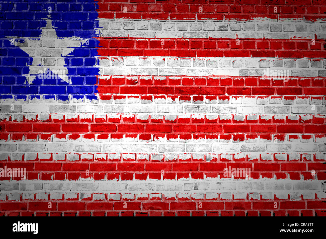 An image of the Liberia flag painted on a brick wall in an urban location - Stock Image