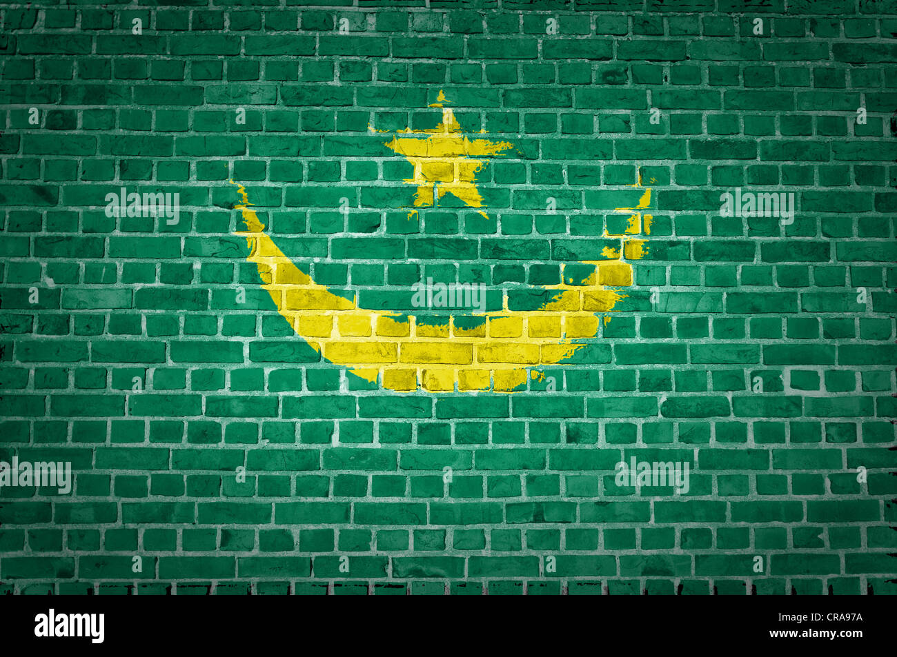 An image of the Mauritania flag painted on a brick wall in an urban location - Stock Image