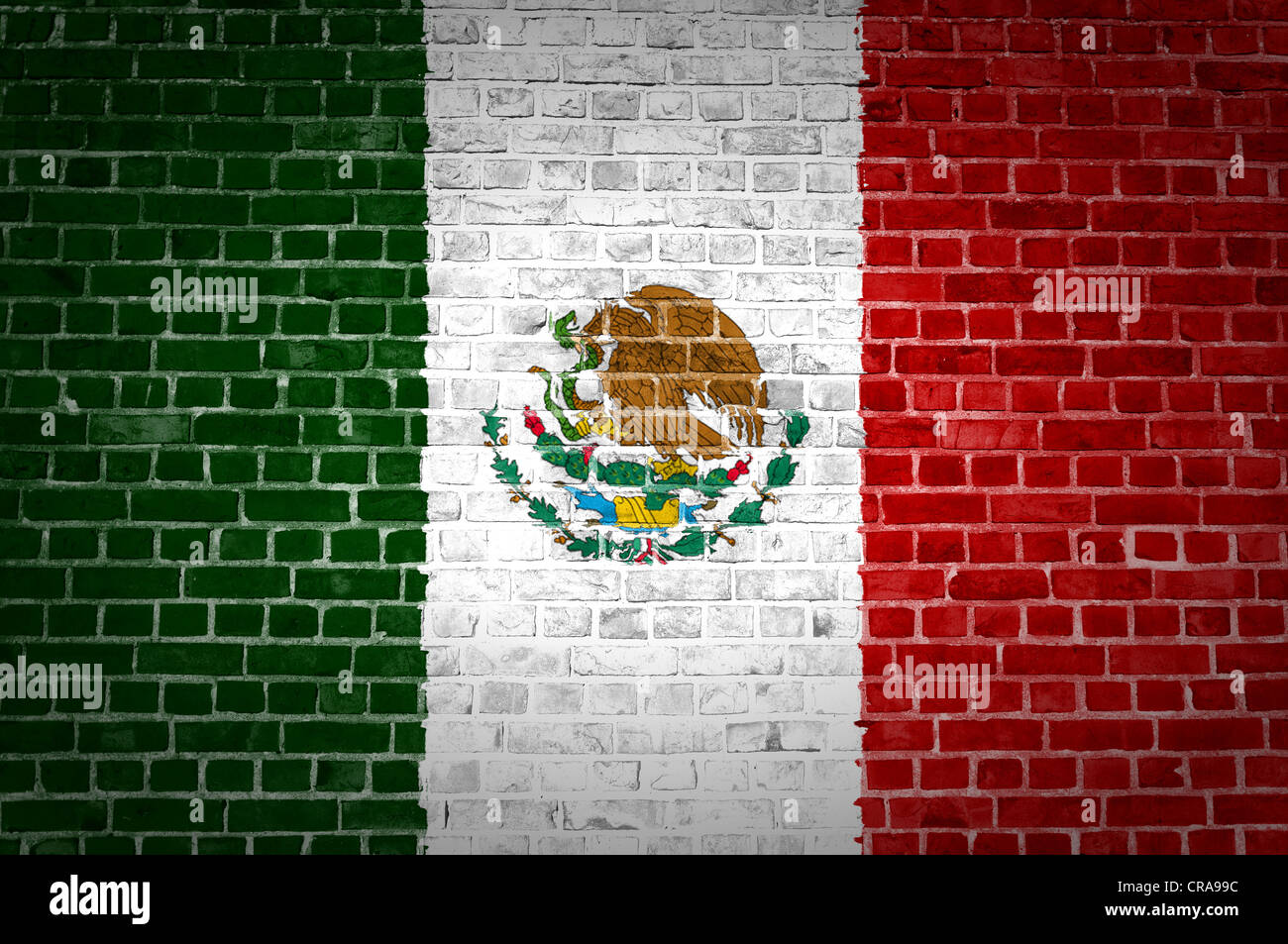 An image of the Mexico flag painted on a brick wall in an urban location - Stock Image
