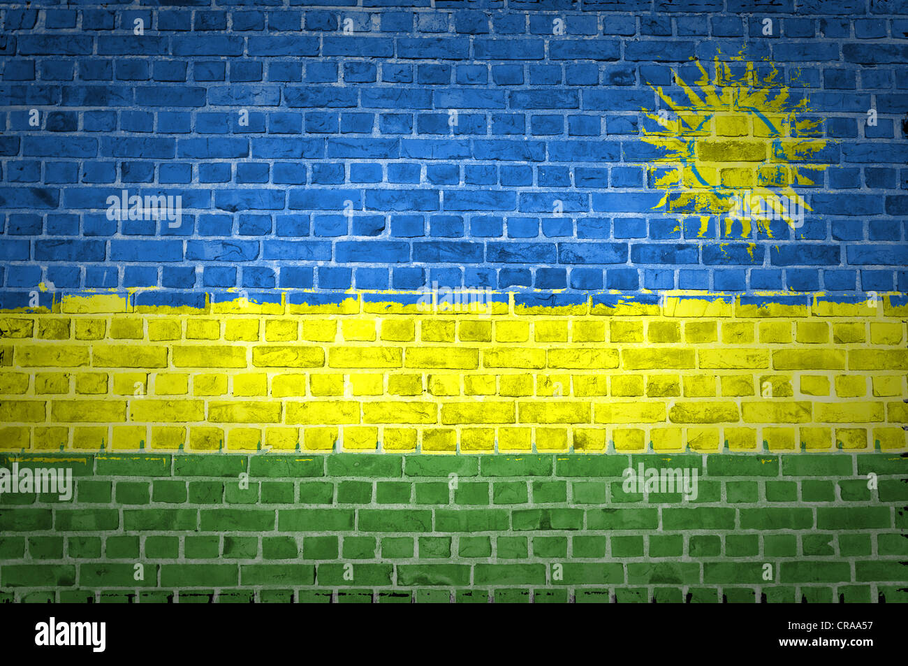 An image of the Rwanda flag painted on a brick wall in an urban location - Stock Image