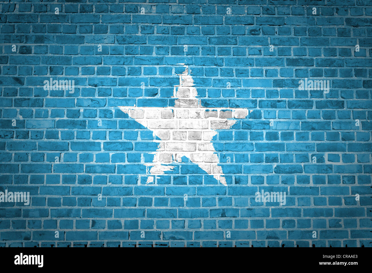 An image of the Somalia flag painted on a brick wall in an urban location - Stock Image