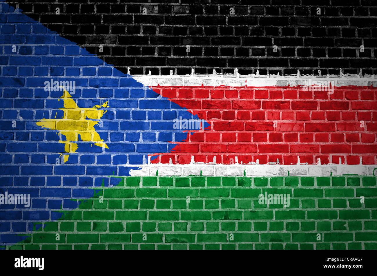 An image of the South Sudan flag painted on a brick wall in an urban location - Stock Image