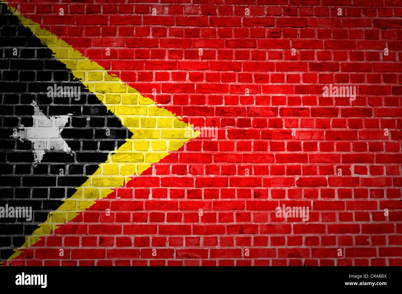 An image of the Timor-Leste flag painted on a brick wall in an urban location Stock Photo