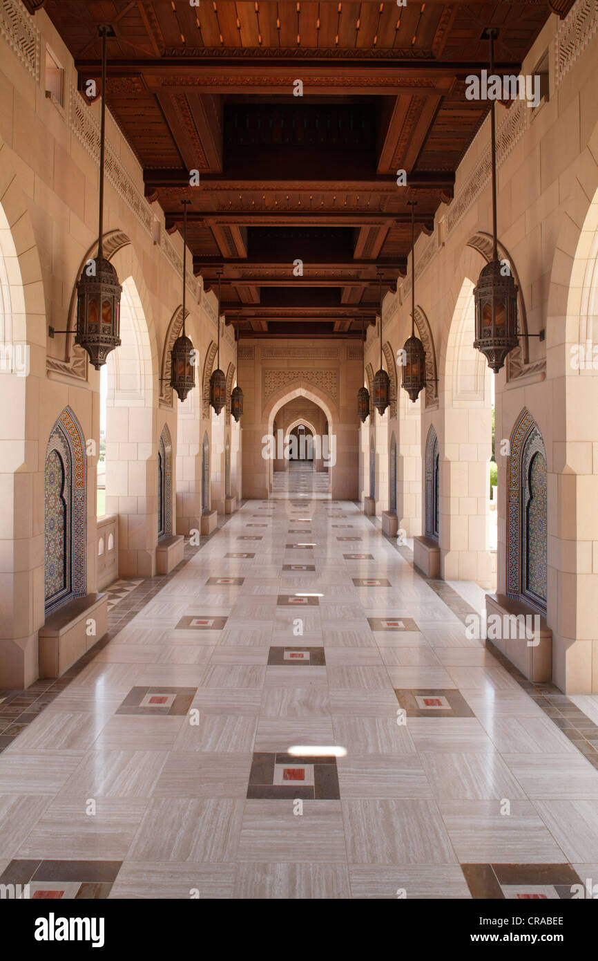 Colonade, wooden ceiling, arch, Sultan Qaboos Grand Mosque, Muscat capital, Sultanate of Oman, gulf states, Arabic - Stock Image