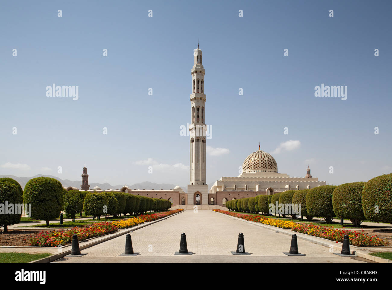 Overview, minaret, flower bed and trees, Sultan Qaboos Grand Mosque, Muscat capital, Sultanate of Oman, gulf states - Stock Image