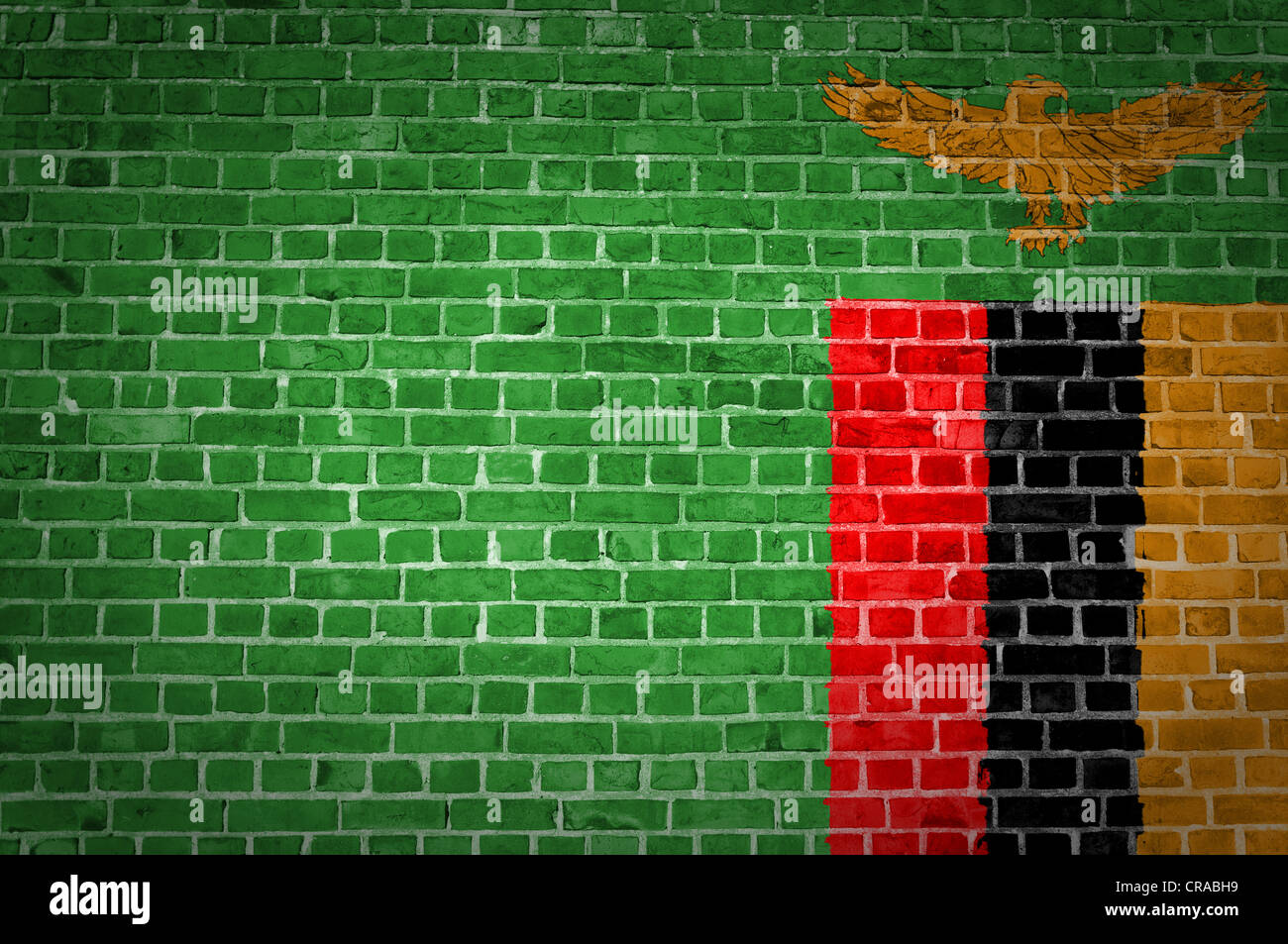An image of the Zambia flag painted on a brick wall in an urban location - Stock Image