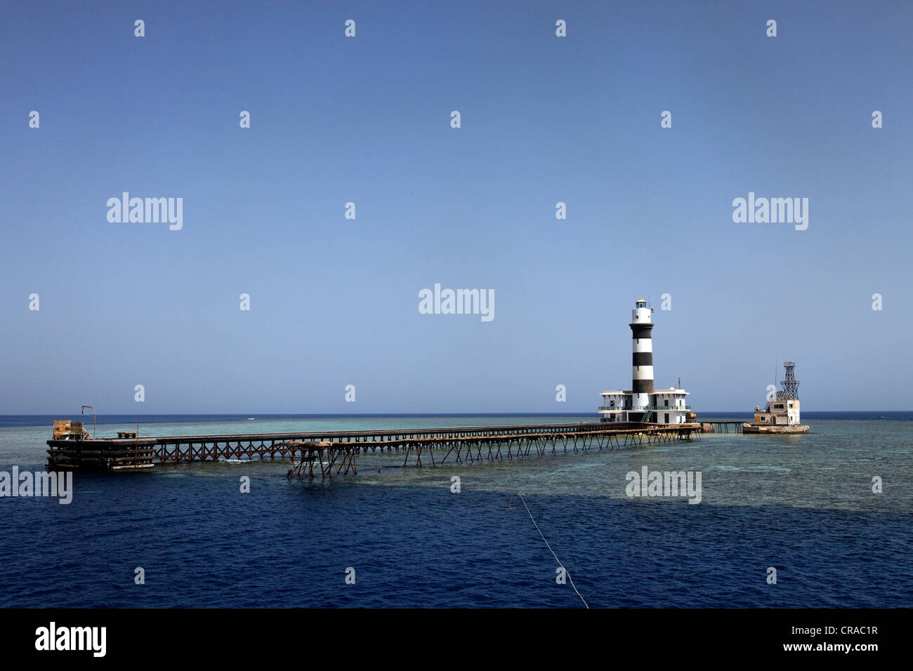 Lighthouse with jetty and coral reef, Daedalus Reef, Egypt, Red Sea, Africa - Stock Image