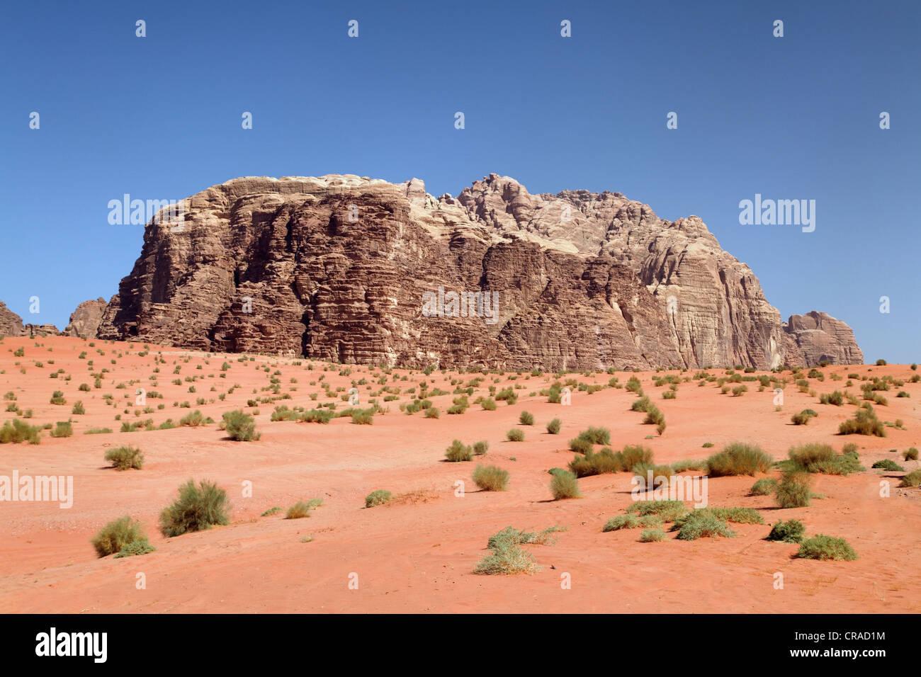 Mountains, vast plains and desert shrubs, Wadi Rum, Hashemite Kingdom of Jordan, Middle East, Asia - Stock Image