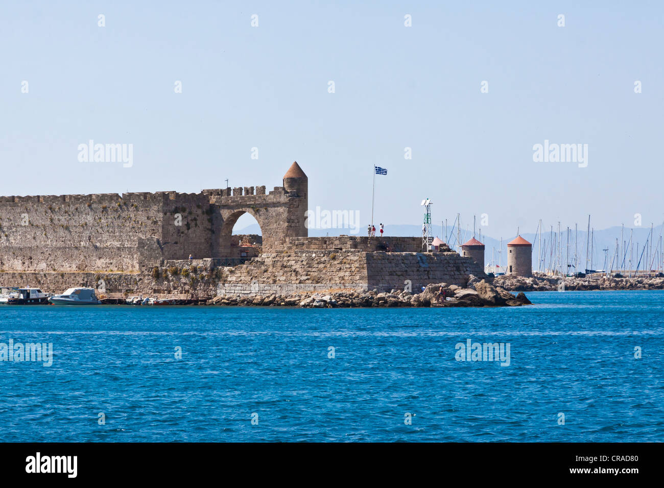 Fortress tower of Agios Nicholas, wind mills, harbour, city of Rhodes, Rhodes, Greece, Europe - Stock Image
