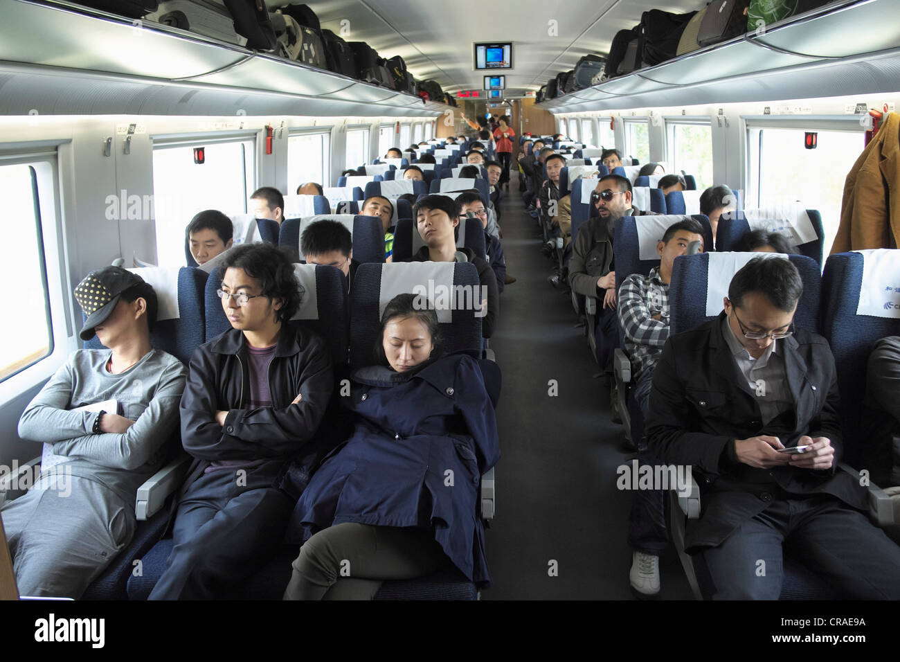 Interior of busy economy carriage on new Beijing to Shanghai high-speed railway in China - Stock Image