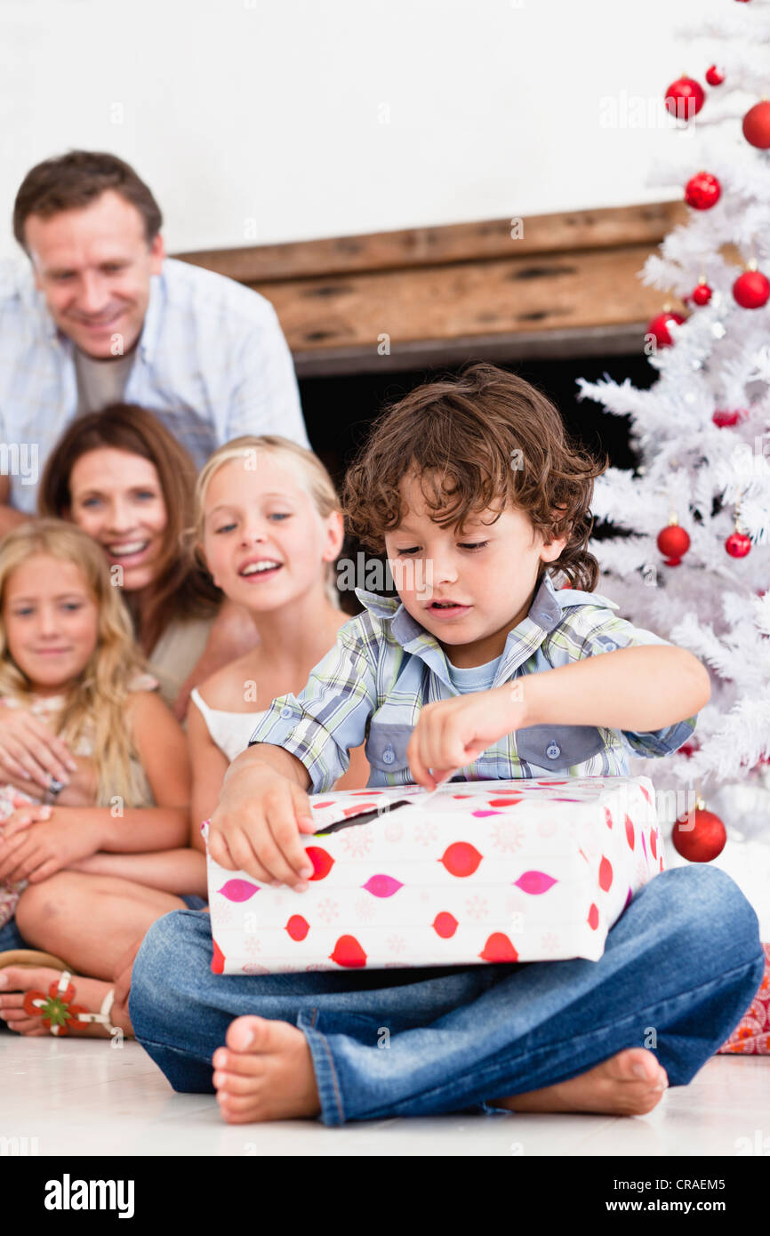 Boy opening Christmas gift Stock Photo