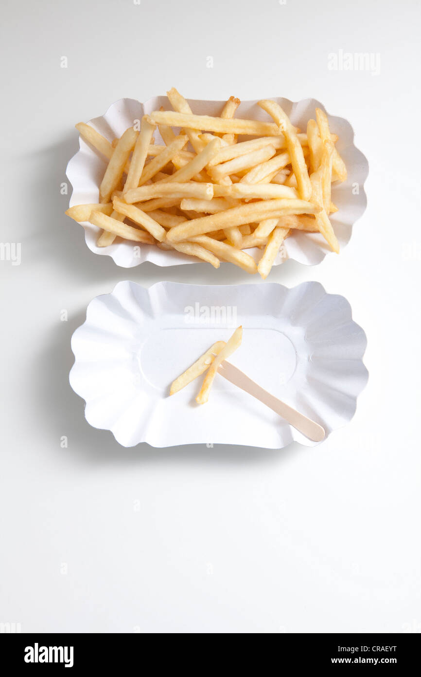 French fries on paper plates, diet - Stock Image