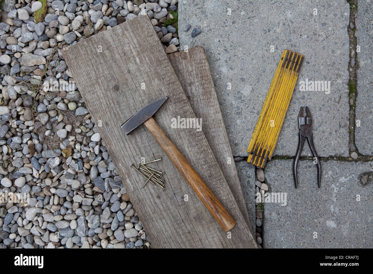 Hammer, folding rule, pliers and wooden boards - Stock Image