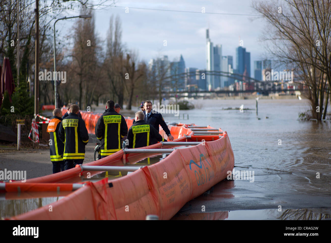 Artificial flood protection dam QUICK DAMM SYSTEM, fire service monitoring the flooding, Frankfurt, Hesse, Germany, Stock Photo