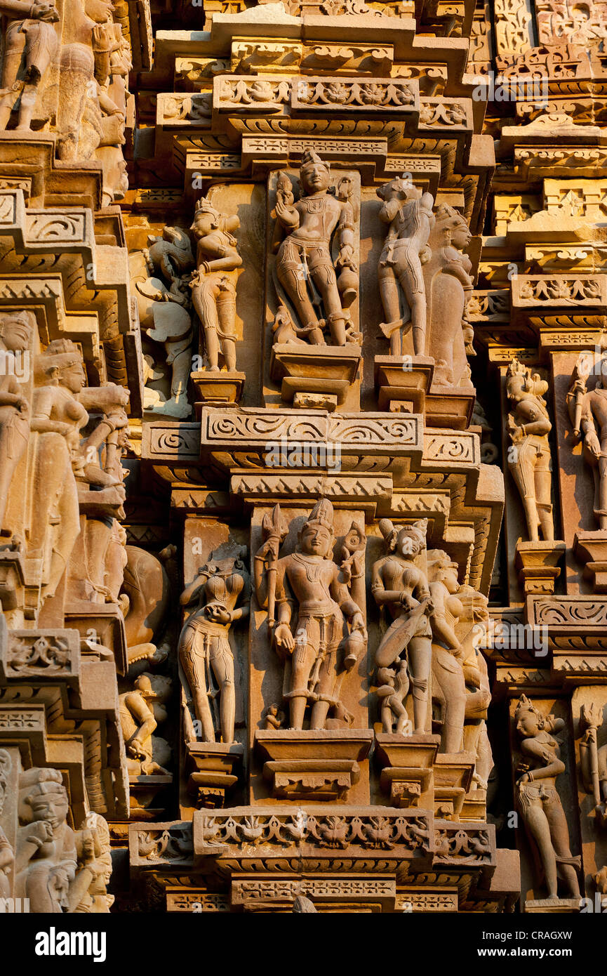 Stone figures, Hindu deities on the facade of a temple, Khajuraho Group of Monuments, UNESCO World Heritage Site, - Stock Image