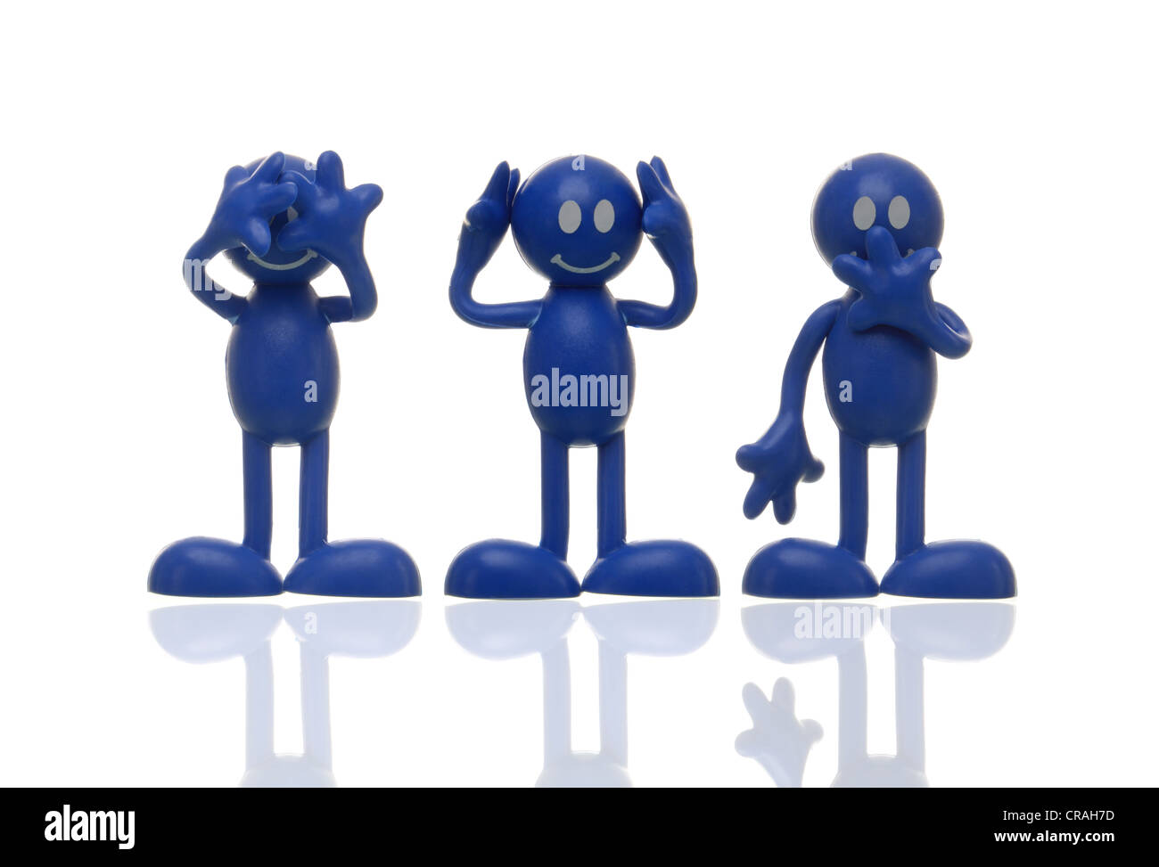 Blue figures hearing nothing, seeing nothing, saying nothing, blind, deaf, silent, symbolic image - Stock Image