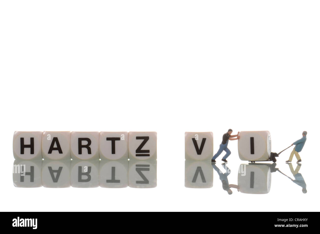 Two small figurines of workmen turning lettering for 'Hartz IV' into 'Hartz V', symbolic image - Stock Image
