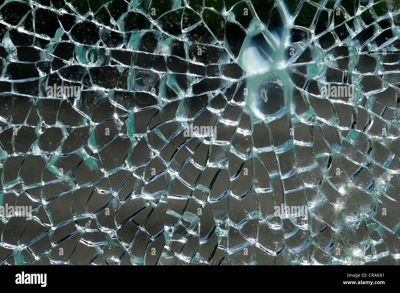 Shattered glass of a phone booth - Stock Image