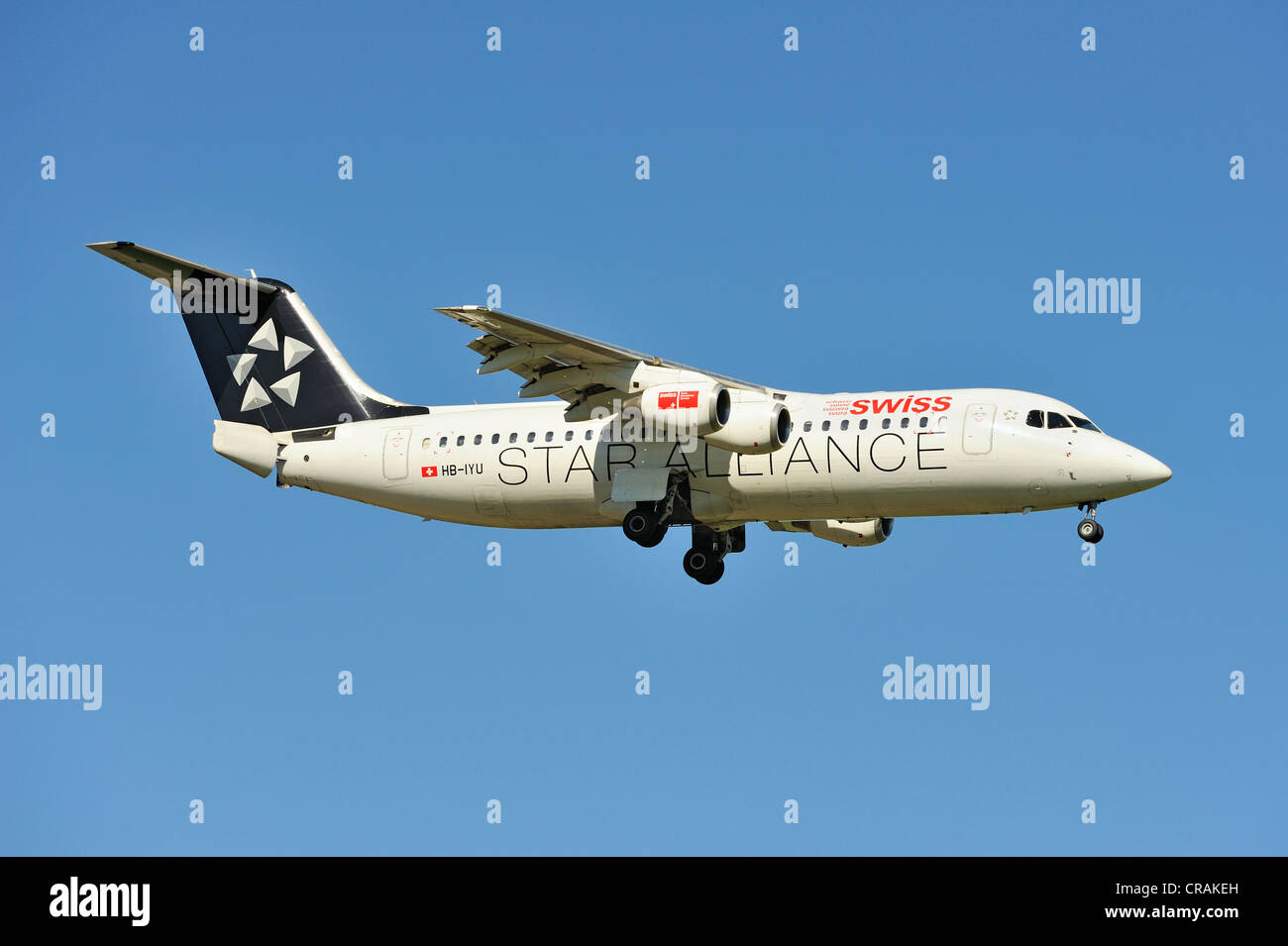 Star Alliance BAE Systems Avro 146-RJ100 during the landing approach to Zurich Airport, Zurich, Switzerland, Europe - Stock Image