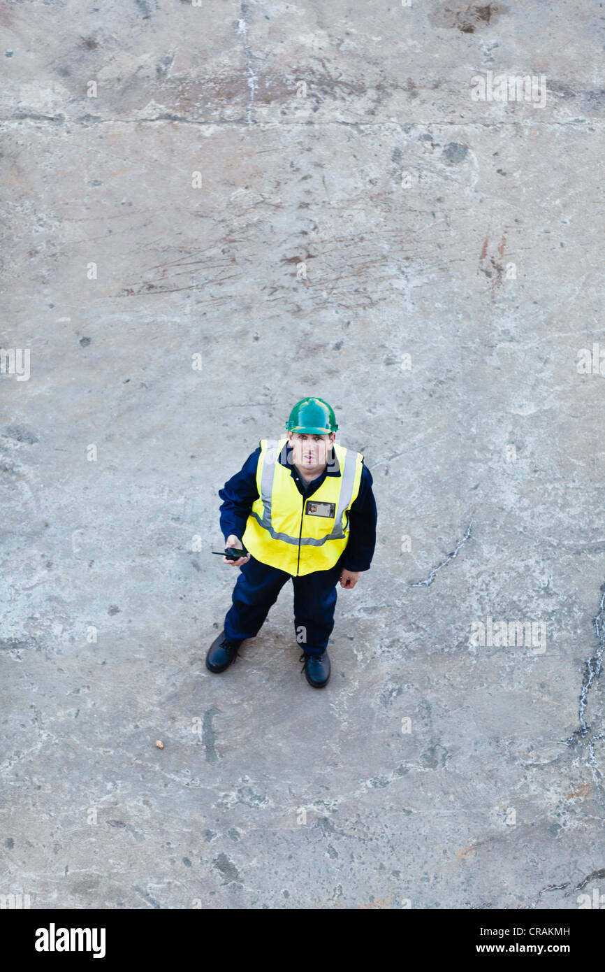Worker standing on dry dock Stock Photo
