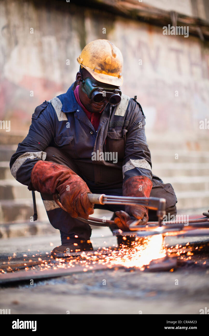 Welder at work on dry dock - Stock Image