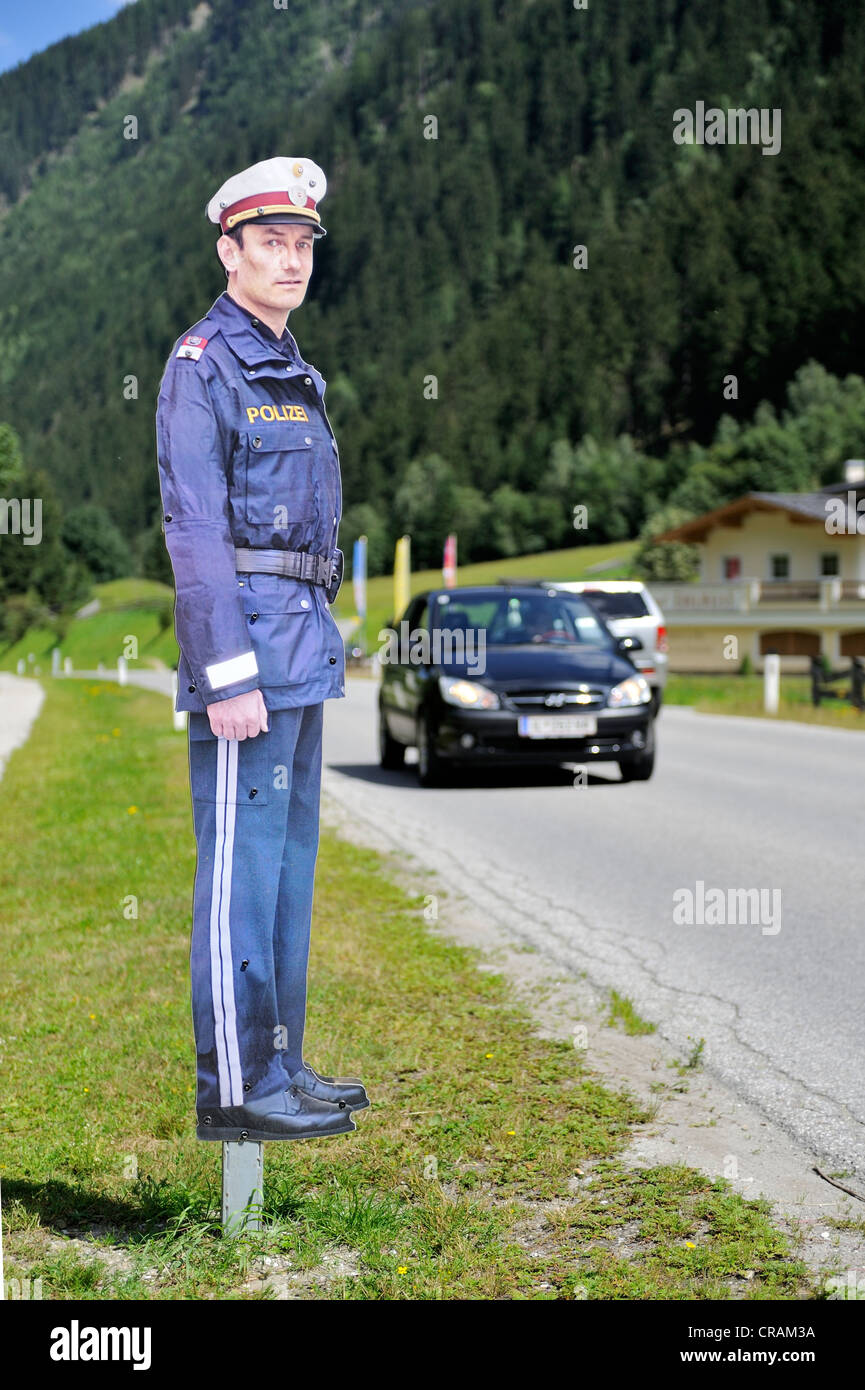 Cardboard policeman on the roadside to increase attention on the road, Tyrol, Austria, Europe - Stock Image