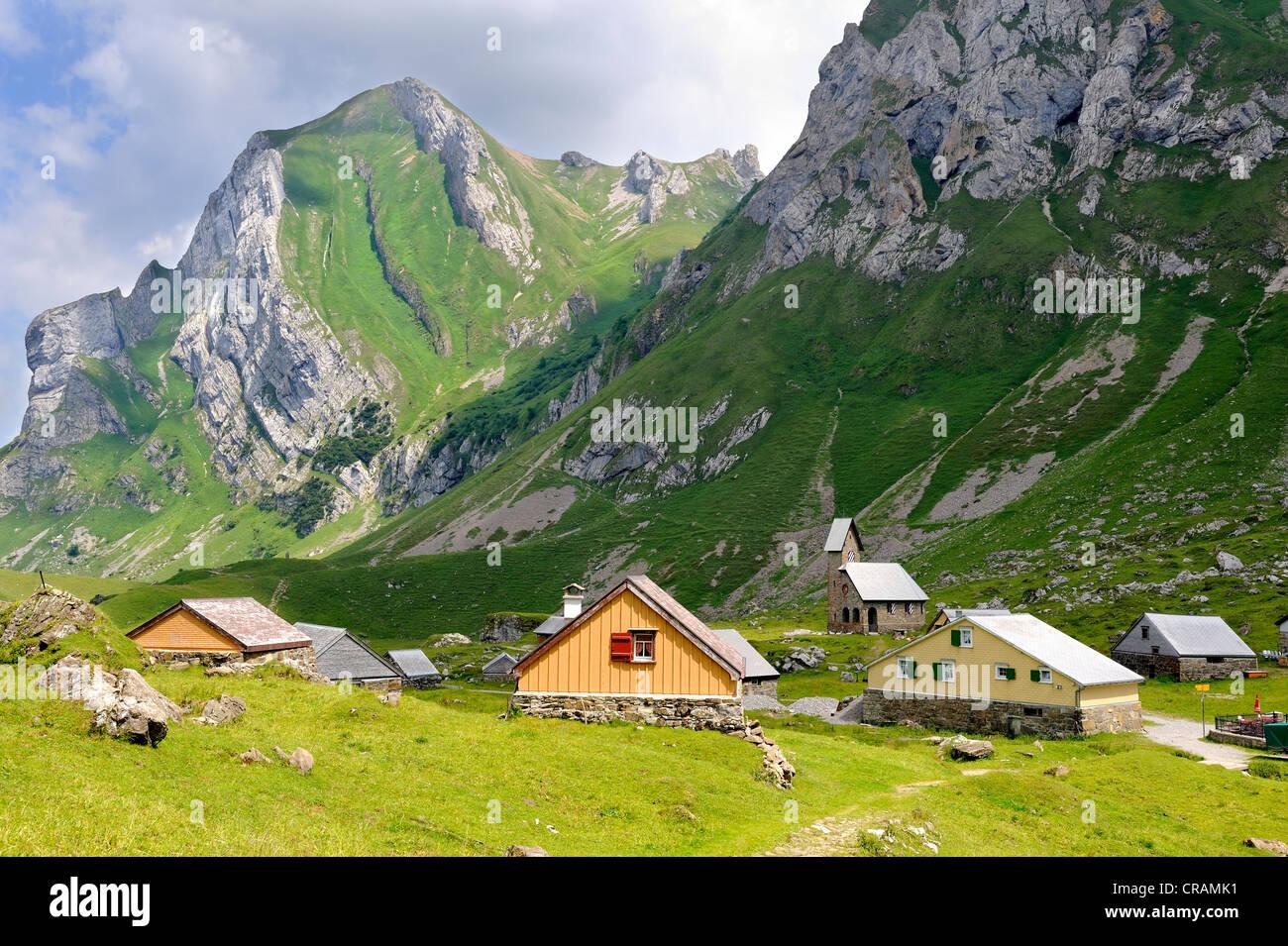 Alpine huts, Alpine hamlet Meglisalp at 1517m altitude in the Appenzell Alps, Canton Appenzell Innerrhoden, Switzerland, - Stock Image