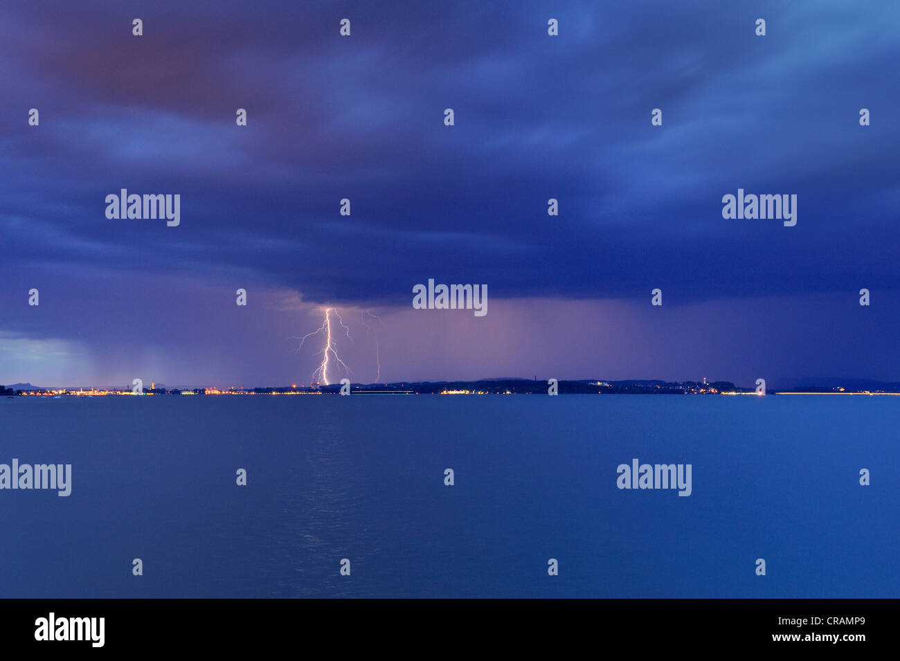Storm clouds, heavy rain and lightning storm over Konstanz on Lake Constance, Baden-Wuerttemberg, Germany, Europe - Stock Image
