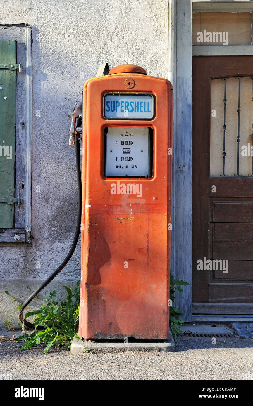 An old petrol pump at an old house, Switzerland, Europe - Stock Image