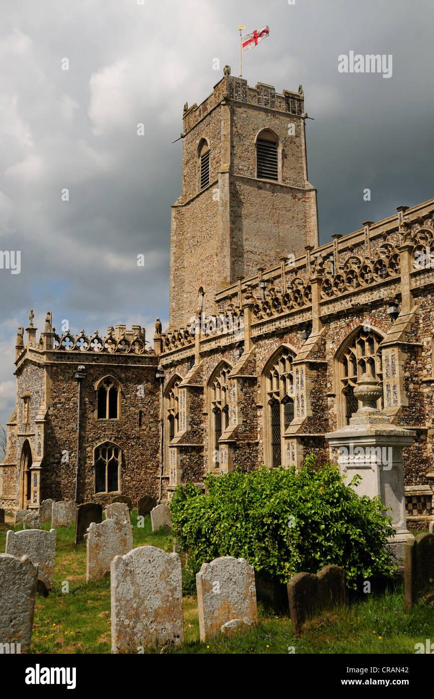 Holy Trinity Church with headstones, Blythburgh Suffolk UK - Stock Image