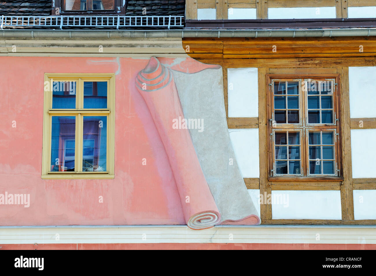 Artistic illustration of a wall being removed to expose a half-timbered facade, Potsdam, Brandenburg, Germany, Europe - Stock Image