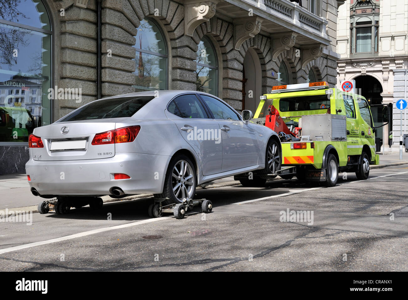 A car is being towed away from a no-parking zone in the historic district of Zurich, Canton of Zurich, Switzerland, - Stock Image