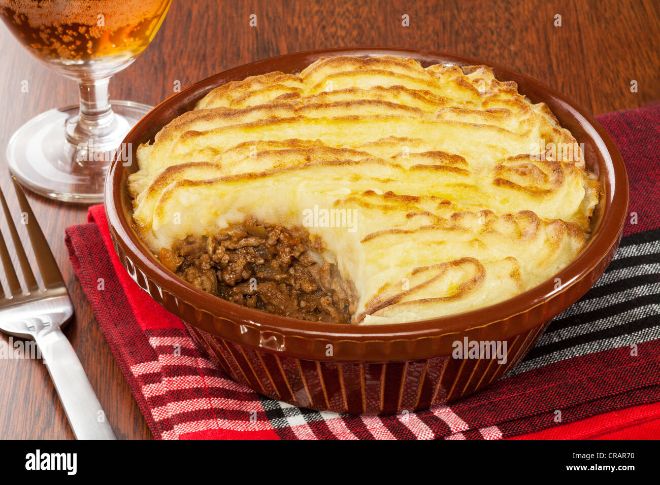 Cottage or Shepherd's Pie with a glass of beer. - Stock Image