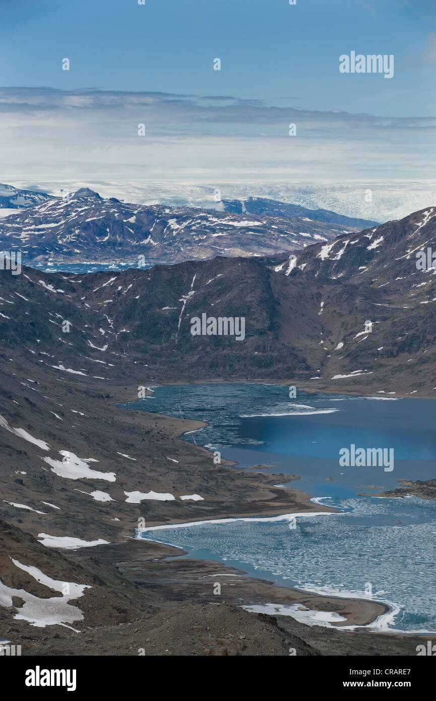 Facing inland towards the ice sheet, view from the mountain of Tasiilaq, also known as Ammassalik, East Greenland, - Stock Image