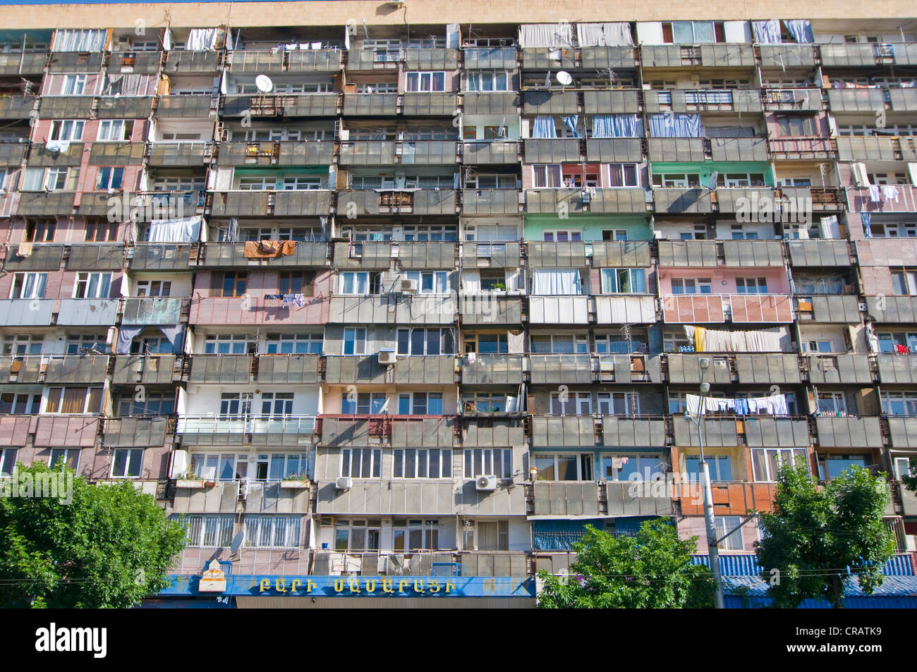Facade of an apartment block with balconies, Yerevan, Armenia, Middle East - Stock Image
