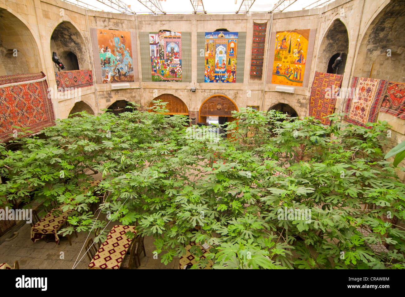 Paintings in the inner courtyard of an historic caravansary, Baku, Azerbaijan, Middle East - Stock Image