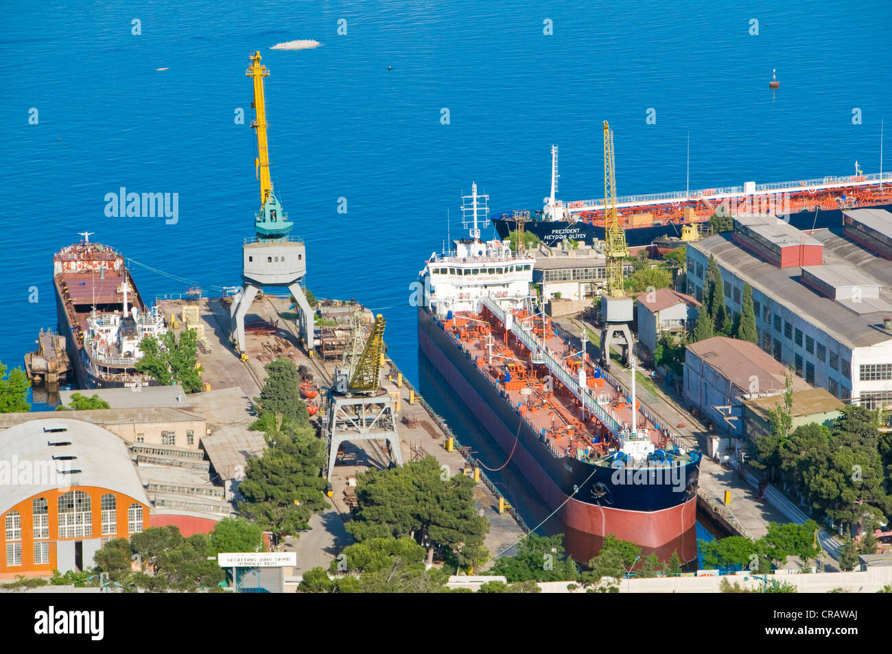 Baku Harbour with a container vessel, on the Caspian Sea, Azerbaijan, Caucasus region, Middle East - Stock Image