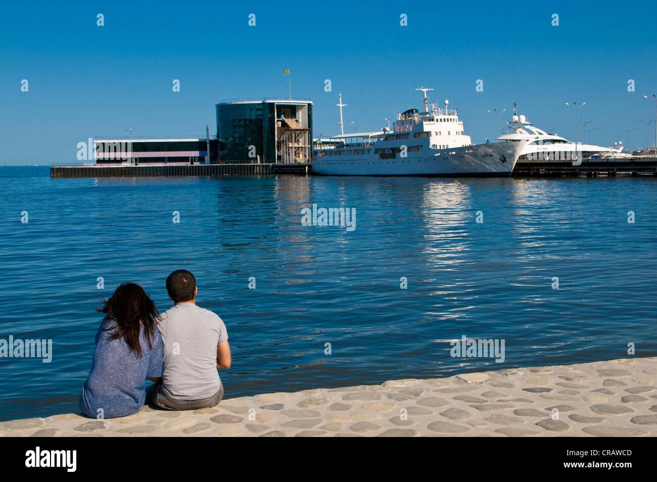 Couple on the promenade of Baku, Azerbaijan, Middle East Stock Photo